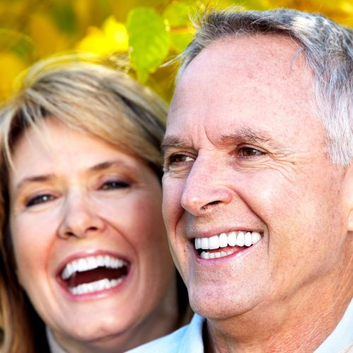 Happy Couple with Yellow Background